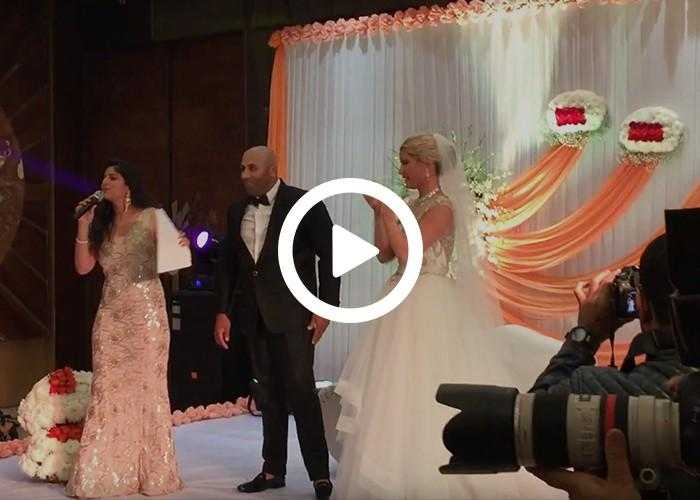 Anchor Dhwani Karia hosting a wedding ceremony for an American Couple